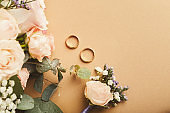 Wedding bouquet and gold rings, closeup