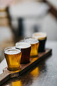 Close-up shot of a variety of beers, also known as a beer flight, as served in a microbrewery.