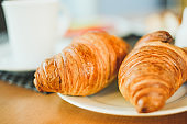 Two croissants on a white plate