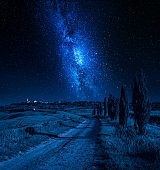 Milky way and country road and small town at night