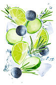 Lime, cucumber, rosemary and blueberry flying with ices and water splash isolated