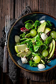 Top view of kale salad with vegetables and avocado