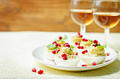 Blue cheese deviled eggs with pomegranate and fresh parsley leaves