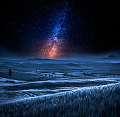 Milky way and field in Italy at night