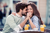 Attractive young couple on a dating in cafe