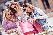 Friends having fun in shopping