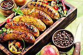 Sausages fried with spices and apple