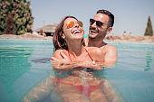 Loving happy couple in pool