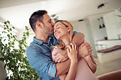 Cheerful young couple enjoying in their home