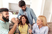 Cheerful group of friends having great time at home