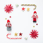 Arrangement of different red and green Christmas tree toys on white background.