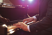 Close-up of a piano player