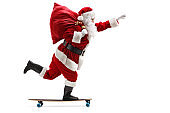 Santa Claus riding a longboard