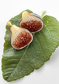 Fig fruits with leaves on white background