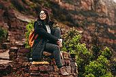 Female traveler relaxing at hillside