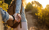 Hiking couple holding hands