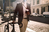 Young businessman going to work by bike