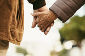 Together forever - Old couple walking hand in hand