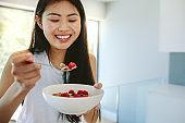 Smiling woman having nutritious breakfast