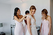 Bridesmaids preparing bride for the wedding day