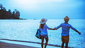 Asian lover couple woman and man travel nature. Travel relax. Walking on the beach. In the summer