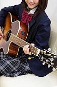 Junior high School student playing guitar