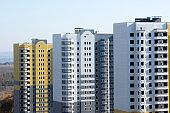 Three unpopulated multi-storey residential building of brick