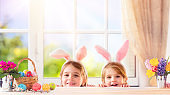 Funny Children With Bunny Ears Playing At Home