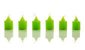 Green candles on white background
