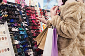 Woman choosing a things for makeup
