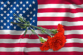 image of America flag and flowers closeup