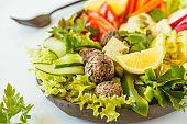 Vegan buddha bowl salad with vegetables, tofu, black beans meatballs and avocado. Healthy vegan food concept.