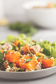 Healthy quinoa salad with roasted pumpkin and greens, macro. Superfood and clean eating concept.
