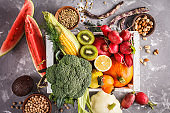 Fruits, vegetables and cereals in a wooden box, top view, healthy food background.
