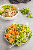 Healthy quinoa salad with roasted pumpkin and greens. Superfood and clean eating concept.