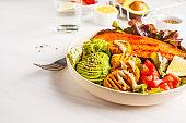 Vegan Rainbow bowl: vegetable meatballs, avocado, sweet potato and salad.