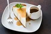 Cheesecake with caramel sauce on white plate