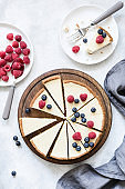 Classic New York cheesecake with fresh berries, top view