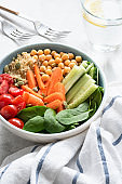 Healthy buddha bowl, salad bowl or nourishing bowl with vegetables, chickpea and quinoa