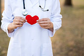 Doctor with a stethoscope holding heart