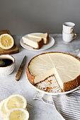 Lemon cheesecake on a table. Sliced lemon cheesecake