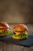 Hamburger with cutlet and cheese.