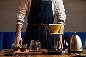 Barista prepare coffee at bar counter