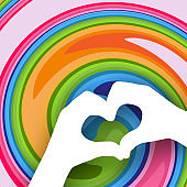 Baby hands in the shape of a heart on a bright colorful abstract background Creative modern youth concept of posters banners templates advertising Element of design Summer clean background Vector