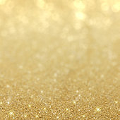 Beautiful gold background with sparkling glitter and bokeh light