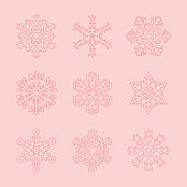Set of Snowflakes of Different Shapes on a Pink Background. Vector Design Elements. Gradient Mesh