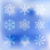 Set of Snowflakes of Different Shapes on a Blue Sky or Frosted Window Background. Vector Design Elements. Gradient Mesh