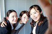 Young women taking a selfie.
