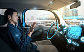 relaxed man in autonomous car. self driving vehicle. autopilot. automotive technology.
