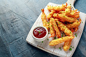 Fried Shrimps tempura with sweet chili sauce on white wooden board